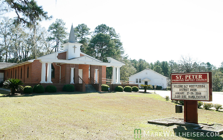 The St Peter Primitive Baptist Church and cemetery at the corner of Centerville and Longbladh roads in Tallahassee, Florida.  The church and cemetery were founded in 1891.  The building is part of the North Leon County Heritage Trail, one of the many points of historic interest.