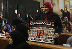 Egyptian relatives of victim in the case of last year's soccer violence in Port Said, attends their trial at a court, in Cairo, Egypt, on Nov. 24. 2014. The case of last year's soccer violence in Port Said which left over 70 dead. Photo by Stringer