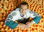 federov.0821.mgk3.jpg 8/20/03<br /> photo illustration by Michael Kitada / The Orange County Register<br />Rubber Ducks courtesy of HB Community Clinic Duck-A-Thon<br />Sergei Federov is the newest Mighty Duck and was introduced to at a press conference at the Arrowhead Pond.