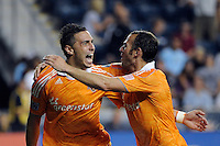 Geoff Cameron (20) celebrates scoring with Brad Davis (11). The Philadelphia Union and the Houston Dynamo played to a 1-1 tie during a Major League Soccer (MLS) match at PPL Park in Chester, PA, on August 6, 2011.