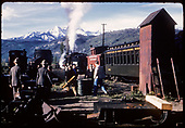 Yards at Ridgway - roofless tank, various R.R, equipment, rail fans.<br /> RGS  Ridgway, CO