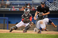 Batavia Muckdogs catcher Pablo Garcia (7) attempts to tag Nick Sergakis (1) sliding home safely as umpire Louie Krupa looks on to make the call during a game against the Brooklyn Cyclones on July 5, 2016 at Dwyer Stadium in Batavia, New York.  Brooklyn defeated Batavia 5-1.  (Mike Janes/Four Seam Images)