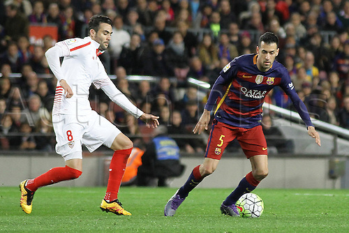28.02.2016. Nou Camp, Barcelona, Spain. La Liga football match. Barcelona versus Sevilla. Busquets in action during the match challenged by Vicente Iborra (Sev)