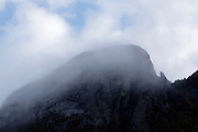 Franconia Notch State Park - Eagle Cliff surrounded by fog in the White Mountains, New Hampshire USA.