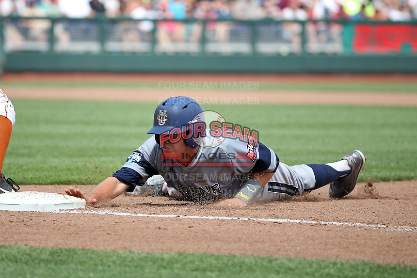 Jerry McClanahan #11 of the UC Irvine Anteaters slides during Game 1 of the 2014 Men's College World Series between the UC Irvine Anteaters and Texas Longhorns at TD Ameritrade Park on June 14, 2014 in Omaha, Nebraska. (Brace Hemmelgarn/Four Seam Images)
