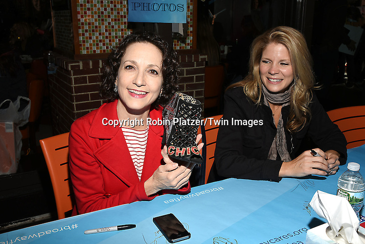 Bebe Neuwirth and Kelli O'Hara attends the Broadway Cares/Equity Fights Aids Flea Market and Grand Auction on September 25, 2016 at the Music Box Theatre and in Shubert Ally in New York, New York, USA. <br /> <br /> photo by Robin Platzer/Twin Images<br />  <br /> phone number 212-935-0770