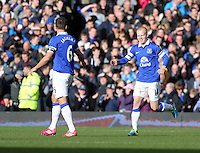 Pictured: Steven Naismith of Everton (R) celebrating his goal with team mate Phil Jagielka (L), making the score 2-1 to his team.  Sunday 16 February 2014<br />