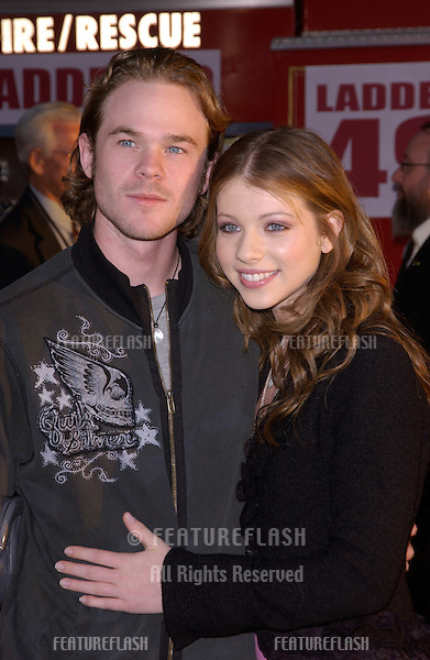 Actor SHAWN ASHMORE & girlfriend actress MICHELE TRACHTENBERG at the world premiere, in Hollywood, of Ladder 49..September 20, 2004