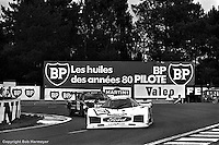 LE MANS, FRANCE: The Ford C100 03 of Manfred Winkelhock, Klaus Niedzwiedz and Klaus Ludwig leads the Porsche 935 K3 009 00030 driven by Skeeter McKitterick, Bob Garretson, Ray Ratcliff and Anny-Charlotte Verney through the Mulsanne Corner during the 24 Hours of Le Mans on June 20, 1982, at Circuit de la Sarthe in Le Mans, France.