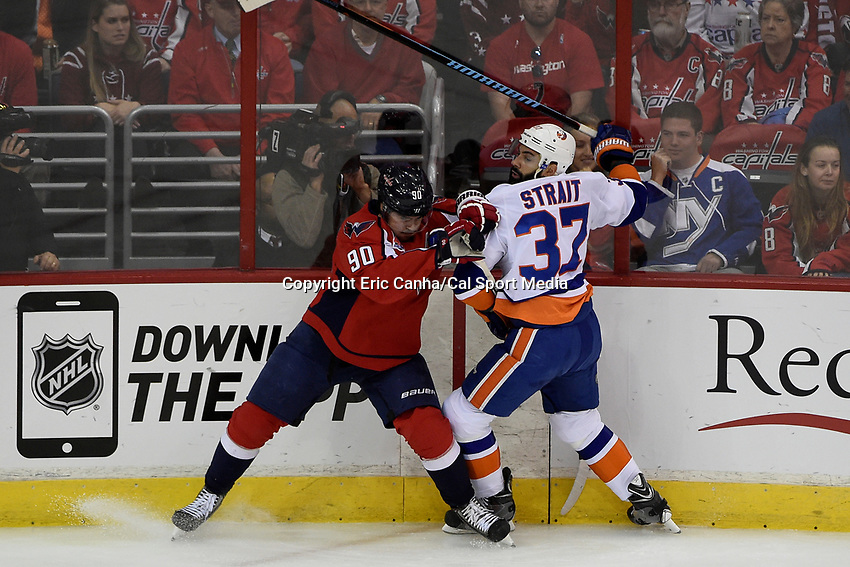 April 23, 2015 - Washington D.C., U.S. - Washington Capitals left wing Marcus Johansson (90) and New York Islanders defenseman Brian Strait (37) in game action during game 5 of the  NHL Eastern Conference Quarter finals between the New York Islanders and the Washington Capitals held at the Verizon Center in Washington DC.  The Capitals defeat the Islanders 5-1 in regulation time to take the lead in the 7 game series 3-2. Eric Canha/CSM