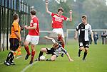2015-10-18 / Voetbal / Seizoen 2015-2016 / Vlimmeren - White Star / Erwin van Dooren (Vlimmeren) met de tackle op Simon Brys<br /><br />Foto: Mpics.be