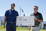 Tony Romo, left and Jonathan Thomas with the check he will donate to charity during the ACC Golf Tournament at Edgewood Tahoe Golf Course in South Lake Tahoe on Sunday, July 14, 2019.