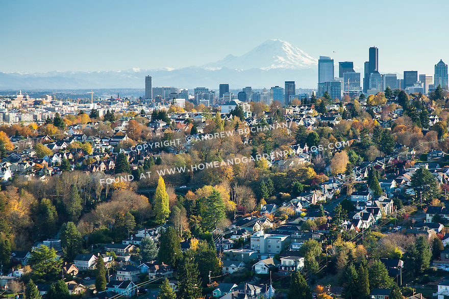 Aerial view of Seattle's Queen Anne neighborhood in the foreground with the downtown skyline and majestic Mount Rainier in the background