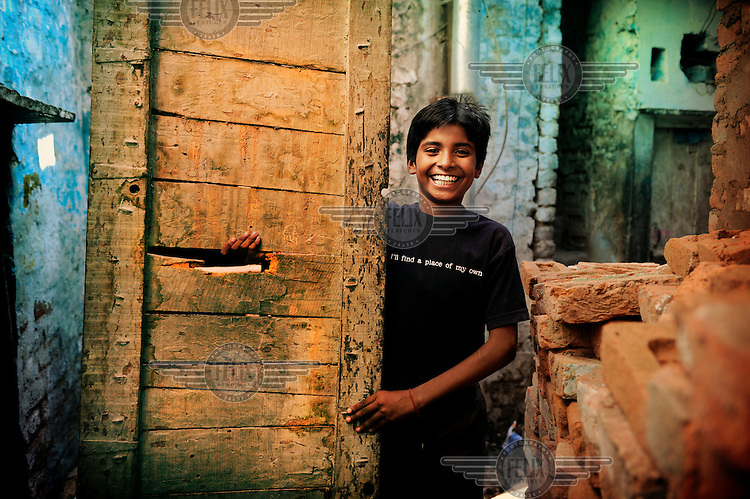"""12 year old Gopal lives in a slum in Delhi. The T-shirt he is wearing says: """"I'll find a place of my own."""" Gopal dreams of finding a place of his own. ."""