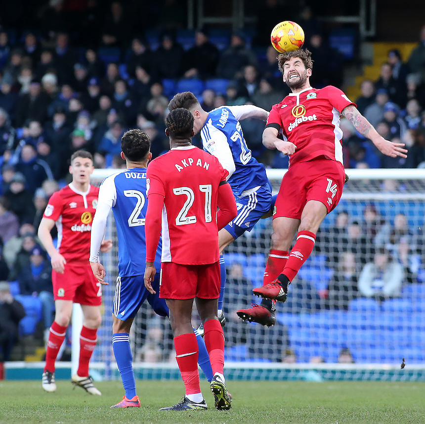 Blackburn Rovers' Charlie Mulgrew heads away from Ipswich Town's Andre Dozzell<br /> <br /> Photographer David Shipman/CameraSport<br /> <br /> The EFL Sky Bet Championship - Ipswich Town v Blackburn Rovers - Saturday 14th January 2017 - Portman Road - Ipswich<br /> <br /> World Copyright &copy; 2017 CameraSport. All rights reserved. 43 Linden Ave. Countesthorpe. Leicester. England. LE8 5PG - Tel: +44 (0) 116 277 4147 - admin@camerasport.com - www.camerasport.com