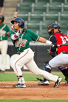 Jose Torres #18 of the Greensboro Grasshoppers follows through on his swing against the Kannapolis Intimidators at Fieldcrest Cannon Stadium August 2, 2010, in Kannapolis, North Carolina.  Photo by Brian Westerholt / Four Seam Images