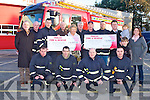 CHEQUE PRESENTATION: Member's of Kerry Fire and Rescue Service presenting cheques to Baile Mhuire and Enable Ireland at Tralee Fire Station on Saturday front l-r: Michael Collins, John O'Donnell, Gearth Elbell and Nathan Tadier. Back l-r: Aidan Kelly (Baile Mhuire), P.J. O'Dowd, Mark Rael, Tommy O'Connor (Baile Mhuire), Stella Boyle (Baile Mhuire), Paddy Garvey (Baile Mhuire), Tommy Kelliher, Nigel Connor, Sean Scally (Enable Ireland), Molly Scally, Thomas Scally, Helen O'Shea (Enable Ireland).
