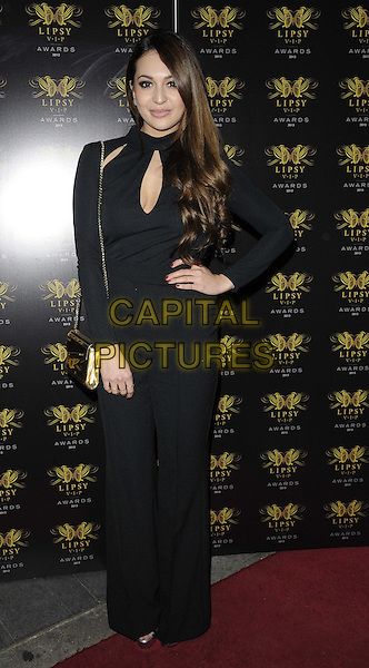 Zara Martin<br /> The Lipsy VIP Fashion Awards 2013, DSTRKT, Rupert St., London, England.<br /> May 29th, 2013<br /> full length black jumpsuit hand on hip cut out away dyed brown brunette hair<br /> CAP/CAN<br /> &copy;Can Nguyen/Capital Pictures