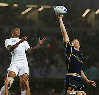 Rugby World Cup Auckland England v Scotland  Pool B 01/10/2011. Courtney Lawes  (England)  jumps against Alaister Kellock  (Scotland).Photo  Frey Fotosports International/AMN Images
