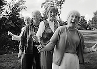 Four elderly women spend good times together outside of a senior center.