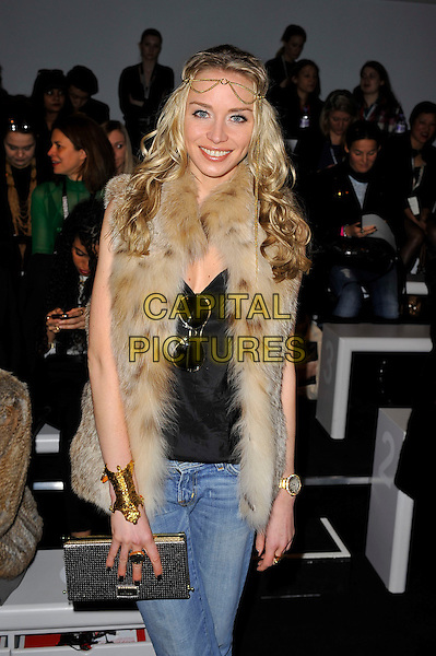 Noelle Reno.attending the Aminaka Wilmont a/w 2013 catwalk show during London Fashion Week, Somersert House, London, England. .19th February 2013.LFW half length beige sleeveless gilet jeans denim gold cuff bracelet clutch bag black top headband.CAP/MAR.© Martin Harris/Capital Pictures.