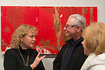 Huntington, New York, U.S. - March 1, 2014 - At the Opening Reception '3 Wild and Crazy Artists' at FotoFoto Gallery, visitors chat at the exhibit 'Red & White Paintings & Photographs – El Vocio Existential' by artist Barry Feuerstein.