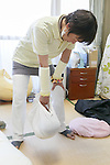 A therapist holds a baby wrapped in cloth in a practice known as Ohinamaki on February 4, 2017, Tokyo, Japan. Parents wrap their babies to give them a feeling of security and help them with their physical development. The Japanese therapeutic method Otonamaki, which translates as ''adult wrapping'' is based on the practice of Ohinamaki to reduce stiffness and posture problems. The therapy  is monitored by a health care professional where participants are wrapped in a large piece of breathable cloth, like a sheet, for about 15 to 20 minutes. (Photo by Rodrigo Reyes Marin/AFLO)