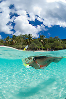 Split level view of snorkeler<br /> Honeymoon Beach.<br /> Virgin islands National Park. St John