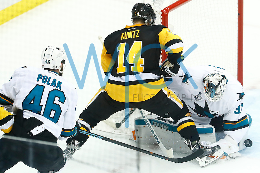 Martin Jones #31 of the San Jose Sharks makes a save in front of Chris Kunitz #14 of the Pittsburgh Penguins in the second period during game five of the Stanley Cup Final at Consol Energy Center in Pittsburgh, Pennsylvania on June 9, 2016. (Photo by Jared Wickerham / DKPS)