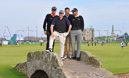 28.09.2013. St Andrews, Kingsbarns, Scotland.   David Lynn, Hugh Grant, Tim Henman and David Howell on the Swilken Bridge on the 18th hole in the3rd round of the Alfred Dunhill Links Championship at Old Course St Andrews