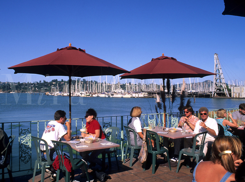 Outdoor cafe with diners in Sausalito California next to San Francisco in Marin Count