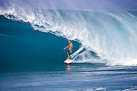 Eight times world professional surfing champion KELLY SLATER (USA) surfing at Backdoor  Pipeline, North Shore Oahu, Hawaii. Photo: joliphotos.com