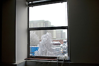 UK. Berkely. 7th December 2010..The reactors at Berkely that will soon be sealed until 2074 as part of the decommissiong programme viewed through an office window at the site. .©Andrew Testa/Panos for the Sunday Times Magazine..