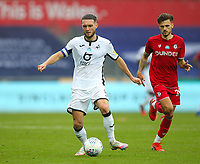 18th July 2020; Liberty Stadium, Swansea, Glamorgan, Wales; English Football League Championship, Swansea City versus Bristol City; Matt Grimes of Swansea City passes the ball while under pressure from Jamie Paterson of Bristol City