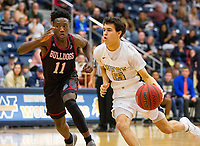 Springdale Bulldogs vs Bentonville West Woverines Basketball - Garrett Wilmot of Bentonville West drives to the basket as Marquis<br />