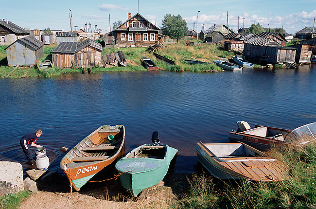 Boats on the river bank in the summer at Lovozero. Kola Peninsula, NW Russia.