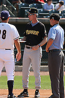 Manager Gary Green #18 of the West Virginia Power meeting with the umpires and opposing manager before a game against the Charleston RiverDogs on April 14, 2010 in Charleston, SC.