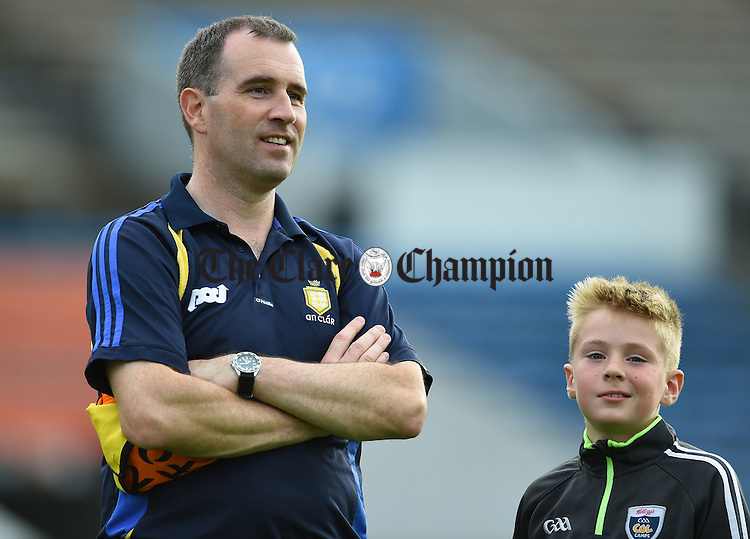 Seanie Mc Mahon, Clare selector with his son following their Intermediate All-Ireland final against Kilkenny at Thurles. Photograph by John Kelly.