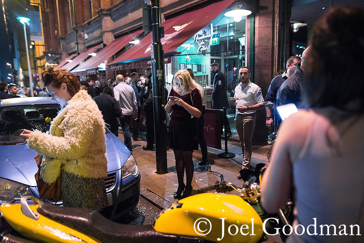 "© Joel Goodman - 07973 332324 . 17/12/2016 . Manchester , UK . Revellers out in Manchester City Centre overnight during "" Mad Friday "" , named for being one of the busiest nights of the year for the emergency services in the UK . Photo credit : Joel Goodman"