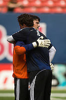 New York Red Bulls goalkeeper Jon Conway (18) greets Houston Dynamo goalkeeper Pat Onstad (18) before the game. The New York Red Bulls defeated the Houston Dynamo 3-0 during a Major League Soccer match at Giants Stadium in East Rutherford, NJ, on August 24, 2008.