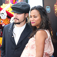 LOS ANGELES, CA, USA - OCTOBER 12: Marco Perego and Zoe Saldana arrive at the Los Angeles Premiere Of Twentieth Century Fox and Reel FX Animation Studios' 'The Book of Life' held at Regal Cinemas L.A. Live on October 12, 2014 in Los Angeles, California, United States. (Photo by Xavier Collin/Celebrity Monitor)