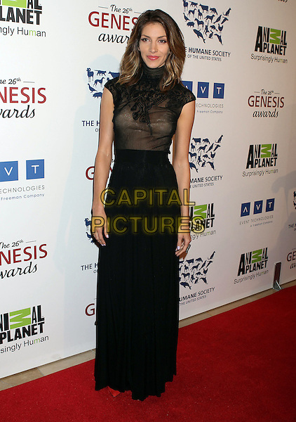 Dawn Olivieri.Davey Detail. 26th Genesis Awards held at The Beverly Hilton Hotel, Beverly Hills, California, USA..March 24th, 2012.full length black sheer dress.CAP/ADM/RE.©Russ Elliot/AdMedia/Capital Pictures.