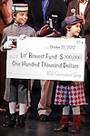 Ethan Khusidman & Zachary Unger during the Curtain Call and check presentation to Christopher Horgan, Jonathan Ziegler and Timothy Carroll from The Lil' Bravest INC Charity at 'Chaplin' at the Barrymore Theatre in New York City on 11/09/2012