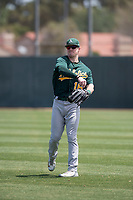 Oakland Athletics outfielder Greg Deichmann (16) warms up between innings of an Extended Spring Training game against the San Francisco Giants Orange at the Lew Wolff Training Complex on May 29, 2018 in Mesa, Arizona. (Zachary Lucy/Four Seam Images)
