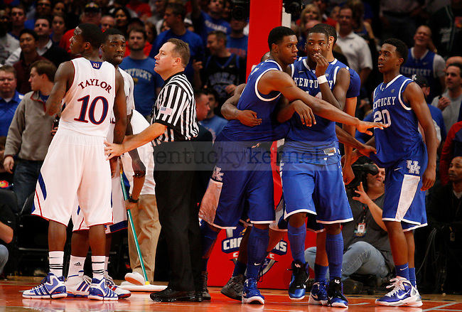 Teammates of the University of Kentucky and Kansas University were separated by game officials in the second half of the Champions Classic game, at Madison Square Garden, in New York, Ny., on Tuesday, Nov. 15, 2011. Photo by Latara Appleby | Staff ..
