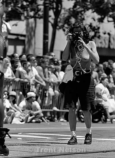Topless photographer at Gay Pride Parade.<br />