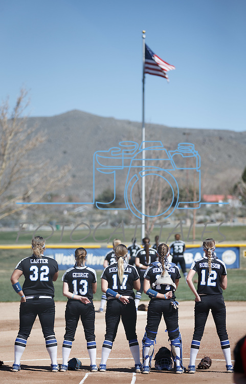 Western Nevada takes the field before the game for the Nation Anthem against Colorado North Western at Edmonds Sports Complex Carson City, Nev., on Friday, March 18, 2016.<br /> Photo by Jeff Mulvihill, Jr.