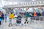 People checking in their baggage at Toronto Pearson International airport