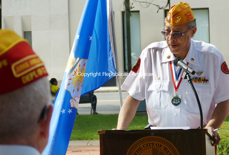 WATERBURY CT. 26 July 2014-072614SV07-Sam Beamon of Waterbury, Marine Corps League, leads the ceremony during Waterbury's 17th annual remembrance of the Korean War armistice on the Green in Waterbury Saturday.<br /> Steven Valenti Republican-American