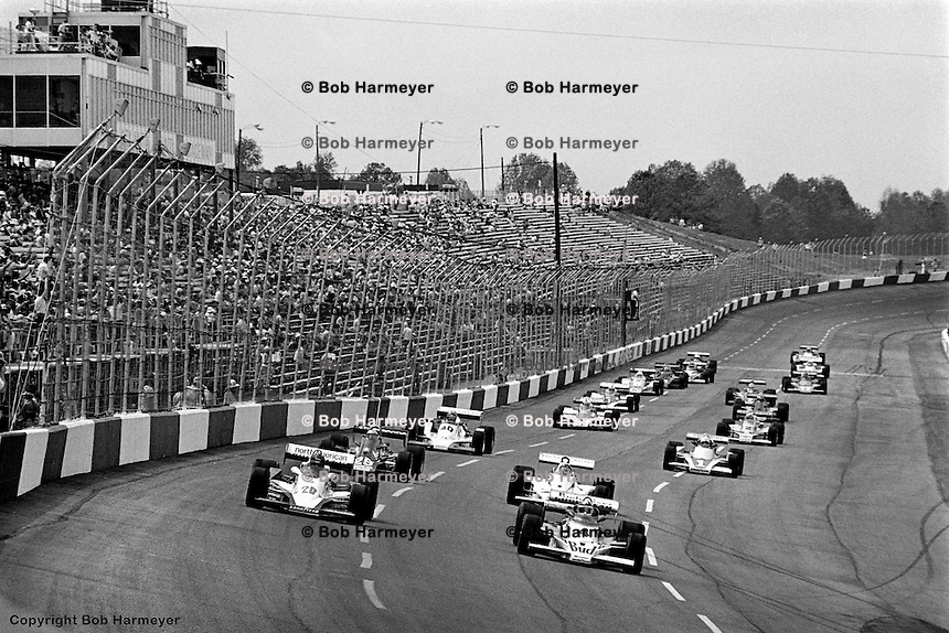 HAMPTON, GA - APRIL 22: Johnny Rutherford (#4 McLaren M24B/Cosworth TC) and Gordon Johncock (#20 Penske PC6/Cosworth TC) lead the field on a pace lap before the second race of the Gould Twin Dixie 125 event on April 22, 1979, at Atlanta International Raceway near Hampton, Georgia.